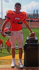 "Alex Gardner with Howard's Rock on the Clemson University set of ""Safety,"" a Disney+ movie about the life of former Clemson football player Ray Ray McElrathbey"