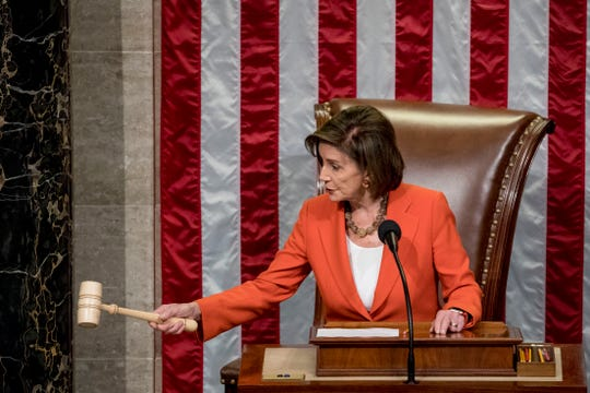 House Speaker Nancy Pelosi of Calif. gavels Thursday as the House votes 232-196 to pass resolution on impeachment procedure to move forward into the next phase of the impeachment inquiry into President Donald Trump.