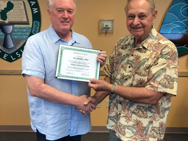 Dr. Donald Platt was recently awarded Professor Emeritus status by the University of Guam board of regents following his retirement from UOG. Dr. Platt served the university for 30 years and is recognized for his outstanding and dedicated teaching of courses in history, conducting research and mentoring students. He is the second retiring faculty member to be granted emeritus status during the past four years. Pictured: Professor Emeritus Dr. Larry Kasperbauer, president of the UOG Society of Emeritus Professors and Retired Scholars congratulating him.