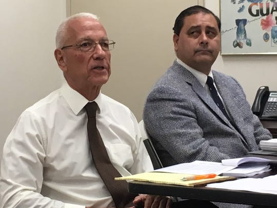 Public Utilities Commission Chief Administrative Law Judge Fred Horecky, left, gives a report on a new Dededo power plant contract as commission legal counsel Anthony Camacho right, listens at the commission's Oct. 31, 2019, meeting in Hagatna.