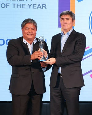 Guam Football Association President Tino San Gil, left, accepts the trophy for the 2019 Asian Football Confederation Social Responsibility Member Association of the Year award in the Aspiring category from AFC Social Responsibility Committee Deputy Chairman Kanatbek Mamatov of Kyrgyz Republic during the 2019 AFC Dream Asia Awards Oct. 30 at AFC House in Kuala Lumpur, Malaysia.