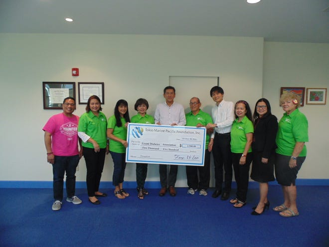 Tokio Marine Pacific Insurance LTD. made its yearly donation to the Guam Diabetes Association to help fund the upcoming  20th annual Guam Diabetes conference on Nov. 10 at the Hilton Guam Resort & Spa. Pictured from left: Patrick Luces, GDA board member; Del Agahan, board member, Clara Peterson, GDA vice-president; Winnie Butler, GDA executive director; Tomohiro (Tommy) Haga, TMPIL president and chief executive officer; Scott Duenas, GDA president; Hisashi (Hisa) Ito, TMPIL chief operating officer; Glynis Almonte, GDA secretary; Rose Grino, GNA; and Ginny Caceres, GDA board member.