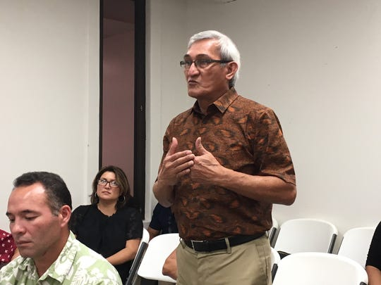 Guam Power Authority General Manager John Benavente stands to address the Public Utilities Commission during its meeting Oct. 31, 2019, in Hagatna.