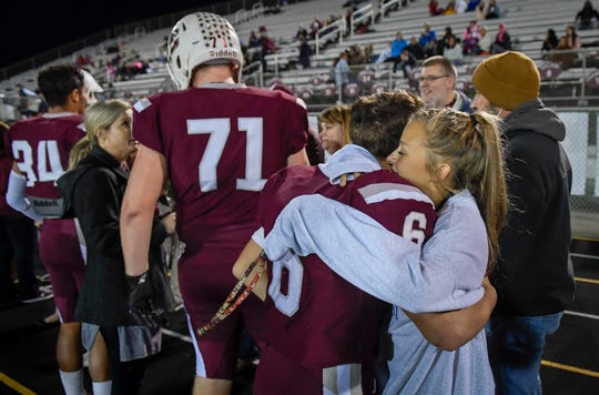 Twins, Morgan gives her brother Logan Green a hug on senior night before the Henderson County vs McCracken County game at Colonel Stadium Friday evening, October 25, 2019.