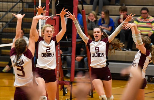 The Lady Colonels celebrate a point as the Henderson County plays the Caldwell County Lady Tigers in the semifinals of the Second Region volleyball tournament at Madisonville-North Hopkins High School Wednesday evening, October 30, 2019.