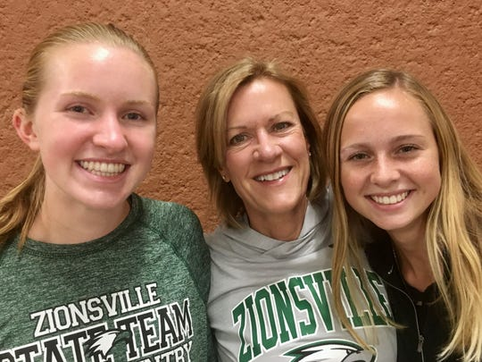From left, Katelynn Wasson, coach Suzanne Rigg, Anna Settle.