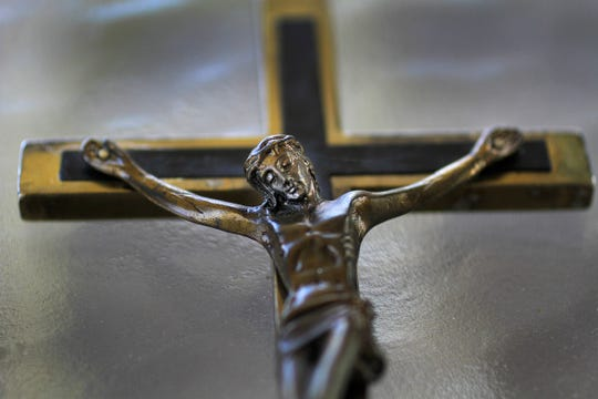 Father Mike Maginot used this crucifix, seen on  on Sept. 13, 2013, to see if demons were present in Latoya Ammons.  When he placed the crucifix on her, she convulsed, showing their presence.
