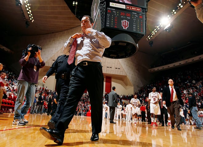 Then-Indiana coach Kelvin Sampson loosened his tie as he walks off the court.