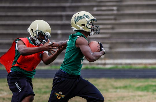 "Crispus Attucks junior DuVuan Love (3) rushes the ball during practice at Crispus Attucks High School, Tuesday, Oct. 29, 2019, Indianapolis. ""Early on I was just focusing on getting the grades right, making sure I had some kids to play football, and winning football games,"" said head coach Abe Tawfeek ""Now my philosophy is kind of more about building up these young men."""