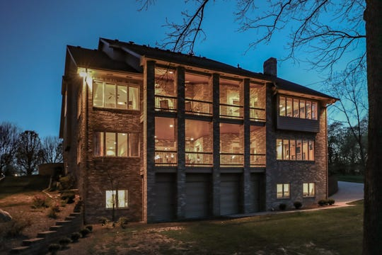 This $800K custom built home in Greenwood features queen-size brick on the exterior.