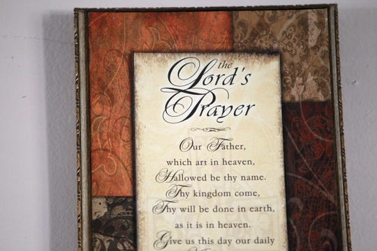 Rosa Campbell keeps The Lord's Prayer framed in her Indianapolis home on Aug. 23, 2013.