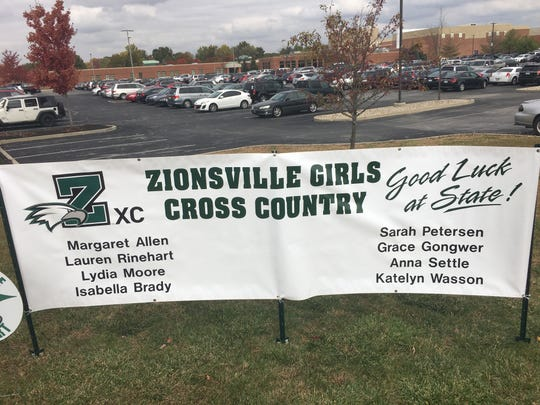A sign outside Zionsville High School offers its support to the Eagles girls cross-country team.