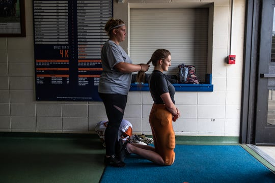 """It stays out of my face when I have my helmet on when it's braided,"" says Lacey Bockting, a senior on the Crawford County Wolfpack's football team."