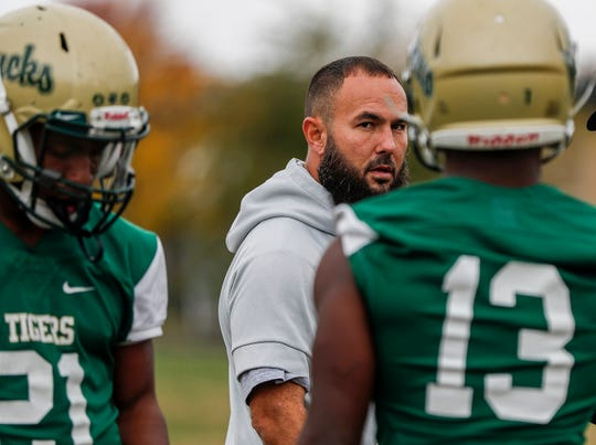 Crispus Attucks head coach Abe Tawfeek watches players lineup to run plays during practice at Crispus Attucks High School, Tuesday, Oct. 29, 2019, Indianapolis.