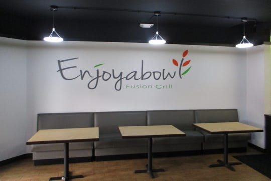 The interior of Enjoyabowl Fusion Grill located at 316 E. Burlington Street in downtown Iowa City.