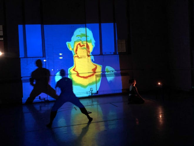 Image of a rehearsal of Brendan Hanks and Angelia Mahaney's Carrier Waves which also includes Bennet Cullen as a dancer and Ian MacMilan/Phosphenes doing video processing.