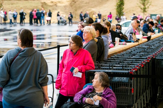 Customers form a line outside Aldi's at its newest store at 5416 Millertown Pike in Knoxville on Thursday, Oct. 31, 2019.