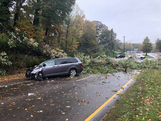 Halloween storms sent a tree into a van, closing southbound lanes of North Broadway at Jacksboro Pike for hours Oct. 31, 2019. Two people inside the vehicle were taken to a hospital, police said.