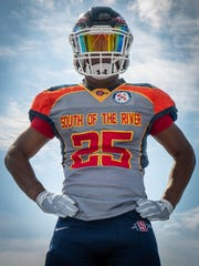 A South-Doyle High School football player models the throwback jersey that his team wore for the Nov. 1 game against Powell.