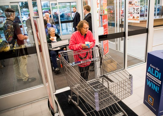 The first customers enter Aldi's newest store at 5416 Millertown Pike in Knoxville on Thursday, Oct. 31, 2019.