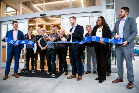 A ribbon is cut as Aldi's opens its newest store at 5416 Millertown Pike in Knoxville on Thursday, Oct. 31, 2019.