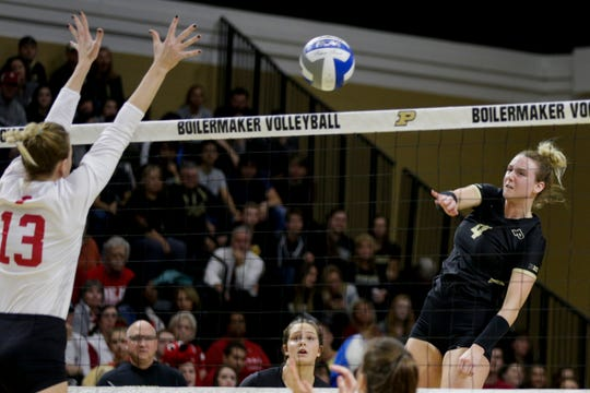 Purdue outside hitter Caitlyn Newton (4) spikes the ball during the second set of a NCAA women's volleyball game, Wednesday, Oct. 30, 2019 at Holloway Gymnasium in West Lafayette. Purdue won, 3-0 (25-16, 25-12, 25-20).