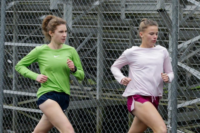 Caroline Jordan, left, and Haley Mansfield run during a cross country practice, Wednesday, Oct. 30, 2019 at West Lafayette Jr./Sr. High School in West Lafayette.