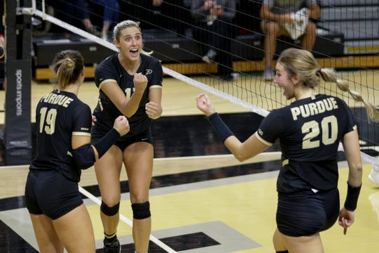 Purdue middle blocker Blake Mohler (17), Purdue defense specialist Jena Otec (19) and Purdue middle blocker Grace Cleveland (20) celebrate a point during the second set of a NCAA women's volleyball game, Wednesday, Oct. 30, 2019 at Holloway Gymnasium in West Lafayette. Purdue won, 3-0 (25-16, 25-12, 25-20).