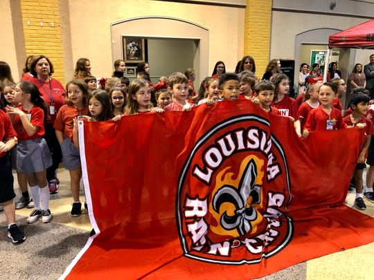 "Our Lady of Fatima Catholic School students cheer for judges for the ""Paint the Town Red"" competition for UL Homecoming Week."