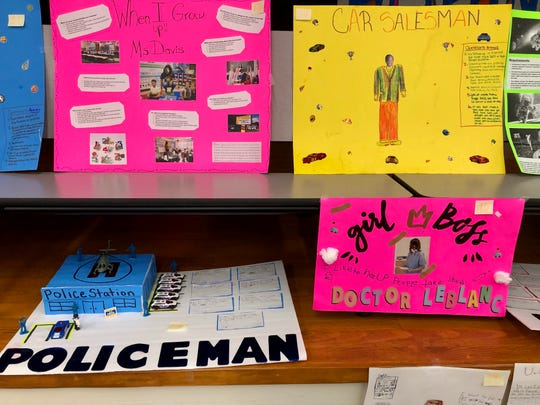 Westside Elementary students create posters about what they want to be when they grow up for the school's annual Career Day Thursday, Oct. 31.