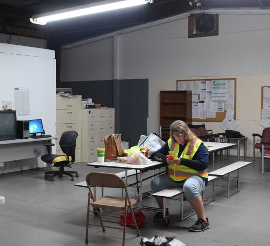 A Lancaster-Fairfield Public Transit employee uses the break room in Lancaster on Oct. 31. Grant-funded renovations will turn the space into a finished office instead of an open garage bay.