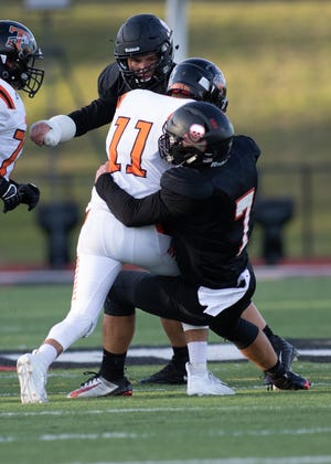Noah Bachmeier (7) and the Pinckney linebacker corps will be busying trying to stop the run Friday at Coldwater.