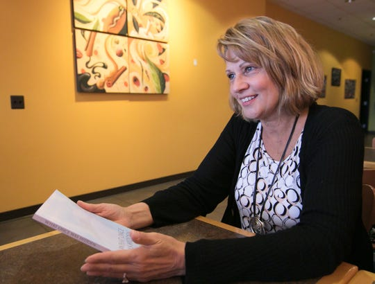 """Highland Township resident Laurie Powers, shown Thursday, Oct. 31, 2019, hopes that her writing inspires hope in the readers of her new book, """"What Once Was Hidden."""""""