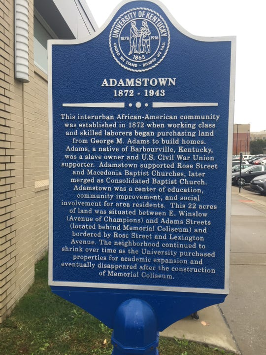 A historical marker outside UK's Joe Craft Center commemorates Adamstown, the African American community once located where the facility now stands.