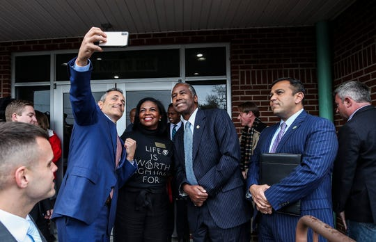 Kentucky Gov. Matt Bevin snaps a picture of himself and Dr. Ben Carson, U.S. Secretary of Housing and Urban Development, who is in Kentucky supporting Bevin in the final campaign days before the November election. At right is Ralph Alvarado, Bevin's running mate.