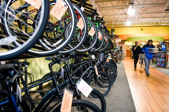A wide selection of bicycles are displayed on Thursday, Oct. 31, 2019, at the Velocipede Peddler in East Lansing. Owner Mark Sanderson is retiring and selling the business that has been a fixture in East Lansing since the 1970s. Much of the merchandise is on sale.