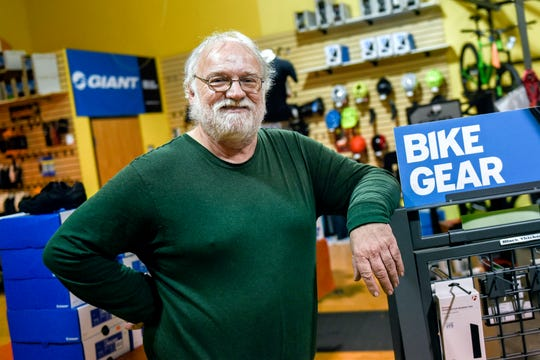 Velocipede Peddler owner Mark Sanderson, photographed on Thursday, Oct. 31, 2019, in the East Lansing store, is retiring and selling the business that has been a fixture in East Lansing since the 1970s.