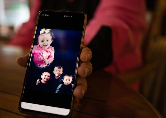 Priscilla Franco-Wallace shows a photo of her late grandsons, Juan, 8, Ramiro, 5, and Manolo Zavala, 3, Thursday, October 31, 2019, at the Comfort Inn in Lansing. The boys perished in a house fire Wednesday morning, Oct. 30, 2019, in the 2000 block of New York Street in Lansing. Four others were injured, including an 18-month-old girl.