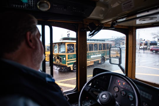 Driver Stewart Kowalk passes the other CATA Grab & Go trolley Thursday, Oct. 31, 2019, in downtown Lansing.  Friday will be the last day of service for the trolleys on the route because CATA is selling them.