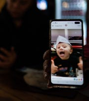 This photo on Priscilla Franco-Wallace's cellphone shows her late grandson, Juan, 8, who along with brothers Ramiro, 5, and Manolo, 3, perished in a house fire, Wednesday morning, Oct. 30, 2019, at their home in the 2000 block of New York Street in Lansing. Four others were injured.