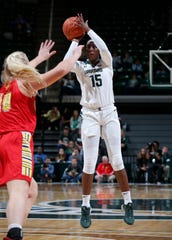 Michigan State's Victoria Gaines shoots against Ferris State's Chloe Idoni in an exhibition game Wednesday, Oct. 30, 2019, in East Lansing, Mich. Michigan State won 85-45.