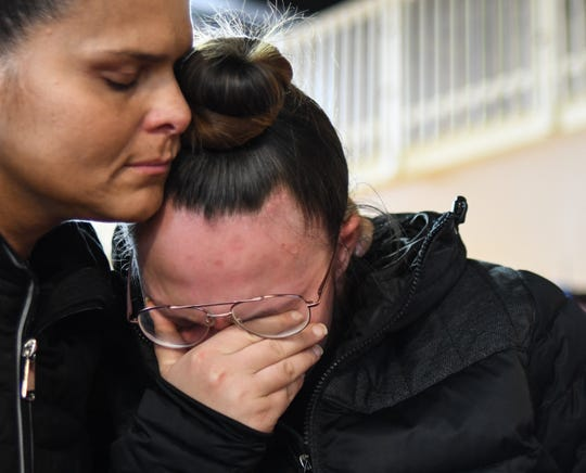 Tammy Franco, left, of Dallas, Texas, tries to comfort Amelia Wallace, 22, of Lansing, Thursday, Oct. 31, 2019, as she talks about her nephews at the Comfort Inn in Lansing. Her sister's three boys, Juan, 8, Ramiro, 5, and Manolo, 3, died Wednesday morning, Oct. 30th in a fire in the 2000 block of New York Avenue.