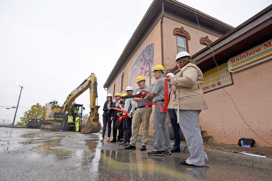 A ribbon-cutting ceremony was held before the demolition of the Rainbow Mortgage building demolition.