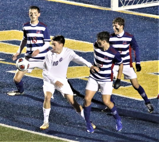 Lexington's Gavin George scored his second consecutive game winning overtime goal as the Minutemen knocked off Division II No. 1 Bay in the regional semifinal on Wednesday at Wooster High School.