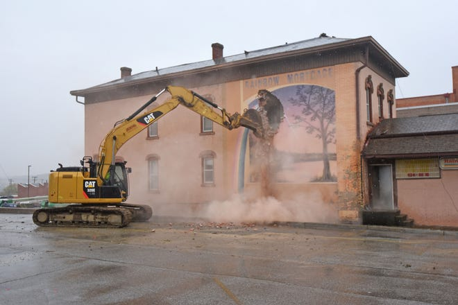 The iconic west wall of the Rainbow Mortgage building was demolished Wednesday afternoon.