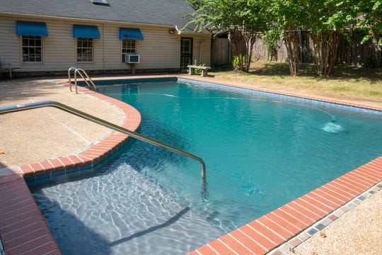 This swimming pool was a bonus for Jeff and Marianna Heimbach. It was not on their list of must-haves in the East Memphis home they purchased.