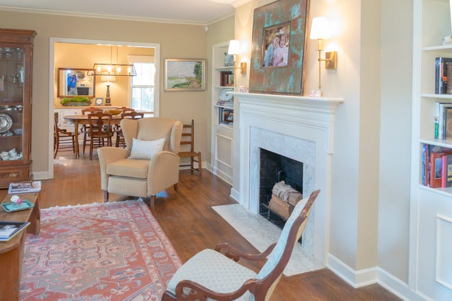 Jeff and Marianna Heimbach love living in this East Memphis home. The living room, featured here, includes white molding, as well as a fireplace and plenty of shelving space.