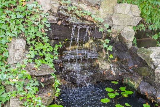 A previous owner of the home spent considerable effort transforming the backyard with fully functional water feature that includes foundations, live plants and several varieties of goldfish.