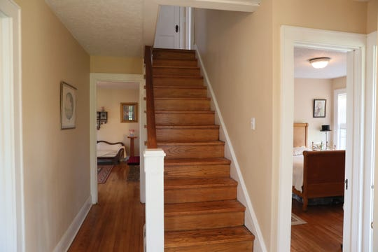 The homeowner spent many  hours restoring the staircase, which had been covered with tile, carpet padding and carpeting.