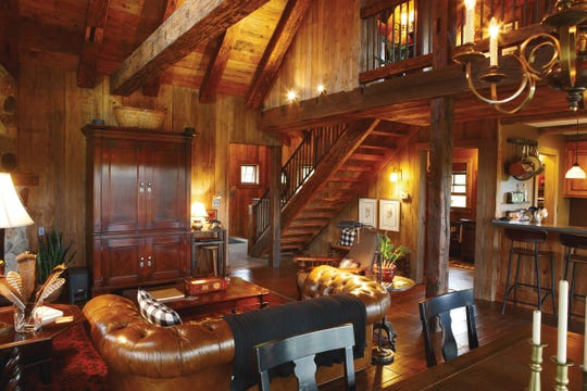 The 2,000-square-foot Sandhill cabin in Kohler was built with reclaimed wood from Wisconsin barns and features a cathedral ceiling.
